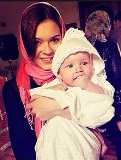 Аделина Сотникова с крестником