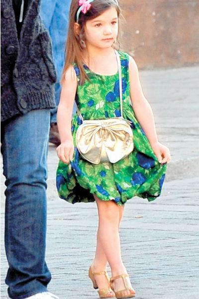 Сури всегда обожала элегантные платья