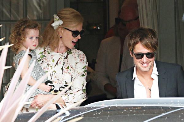Николь с мужем и младшей дочерью Фейт