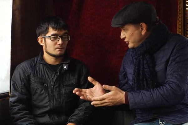 Александр Кинжинов с ведущим Маратом Башаровым