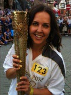 Ольга Шелест была счастлива стать факелоносцем на Олимпийских играх в Лондоне. Быть может, ее опытом воспользуются и во время путешествия факела по России...