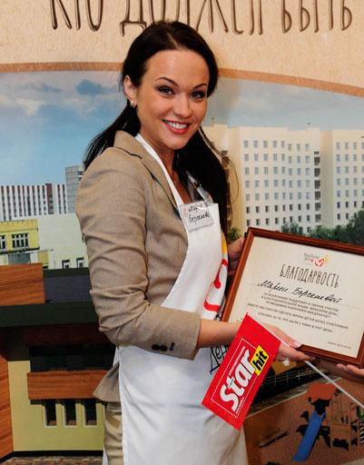 Мария Берсенева с дипломом акции