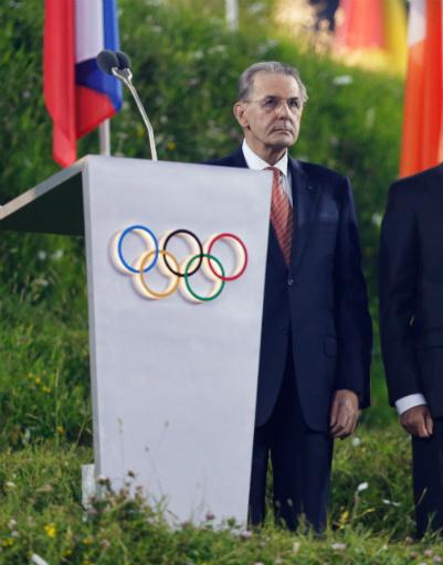 Президент МОК Жак Рогге. На фоне русского флага, между прочим