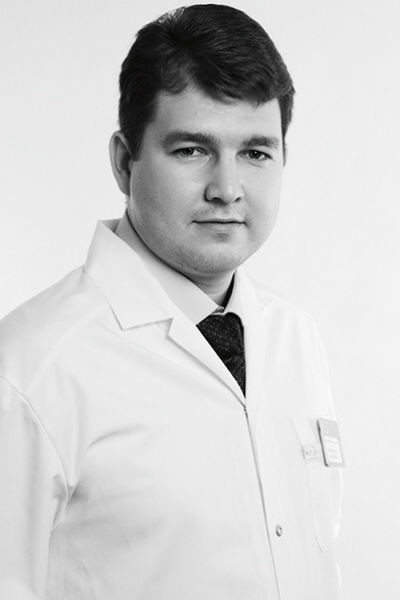 Игорь Валерьевич Гуляев, пластический хирург клиники «К+31», кандидат медицинских наук