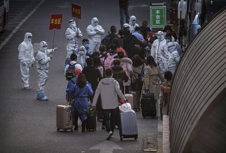 Все прибывшие в Китай должны провести две недели в отеле на карантине