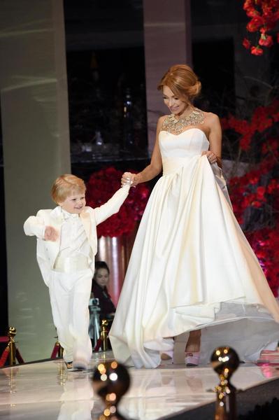 Евгения пользуется успехом в модельном бизнесе: в 2016 году она приняла участие в показе известного дизайнера Галии Ахматовой, где вывела на подиум своего сына