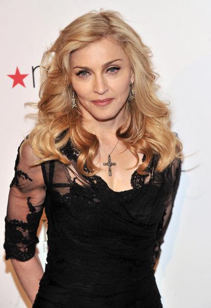 Мадонна уговаривает пару обосноваться в США